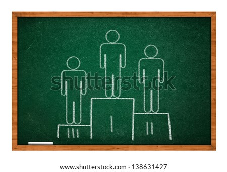Winning pedestal on green chalkboard with wooden frame. - stock photo