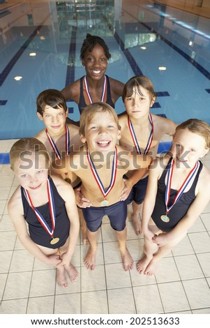 Winning swimming team - stock photo