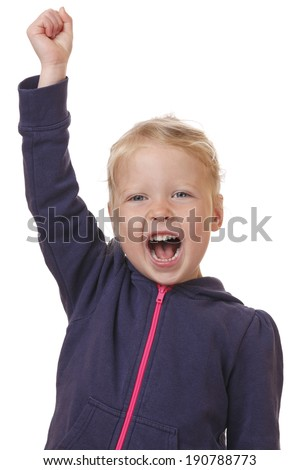 Winning young girl puts arm in the air on white background - stock photo