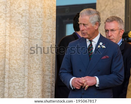 WINNIPEG, CANADA - MAY 21,2014: Charles, Prince of Wales exits Manitoba Legislative Building after speech to Provincial Assembly, during Canadian Royal Tour. - stock photo