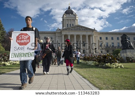 WINNIPEG, CANADA - SEPTEMBER 17: Daemon Bath leads a march departing the Manitoba Legislative Building marking the first anniversary of Occupy Wall Street on September 17, 2012 in Winnipeg. - stock photo