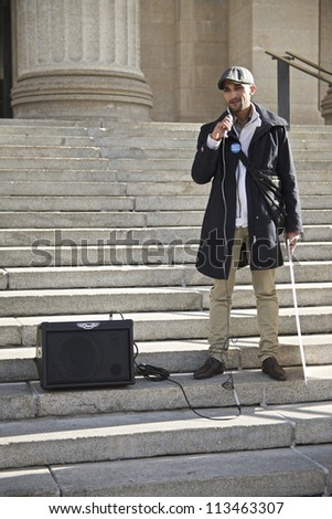 WINNIPEG, CANADA - SEPTEMBER 17: Student Mohamed Ahdelkarim Ammoamon addresses a group marking the first anniversary of the Occupy Wall Street protests on September 17, 2012 in Winnipeg. - stock photo