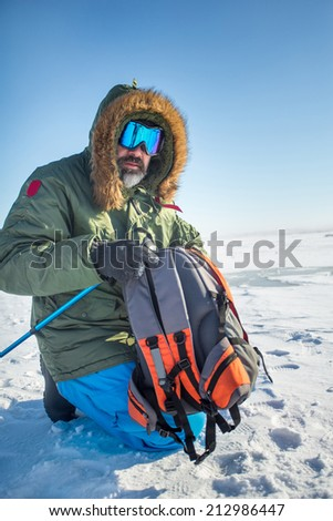 winter adventurer explorer over sky and snow background. Active healthy sport lifestyle - stock photo