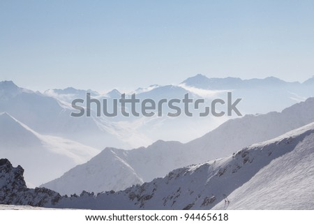 Winter alpine mountains covered with snow - stock photo