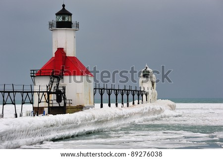 Winter at St. Joseph Lighthouse, Ice encased outer Lighthouse, Michigan USA - stock photo