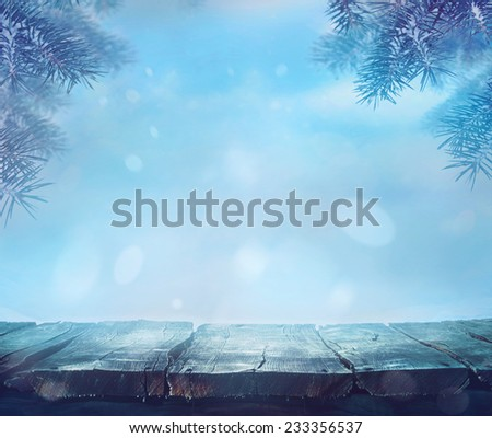 Winter background. Winter snow landscape with wooden table in front. - stock photo
