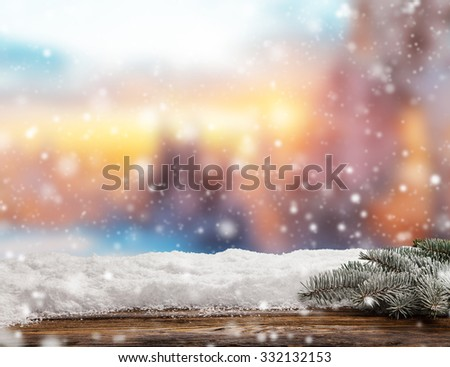 Winter background with pile of snow and blur evening landscape. Empty wooden planks on foreground. Copyspace for text - stock photo