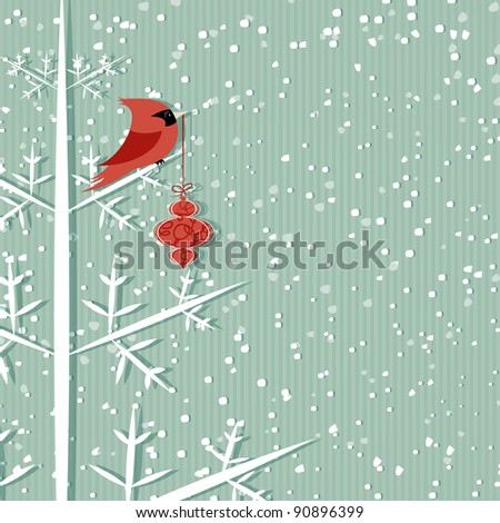 Winter background with red cardinal holding Christmas decoration - stock photo