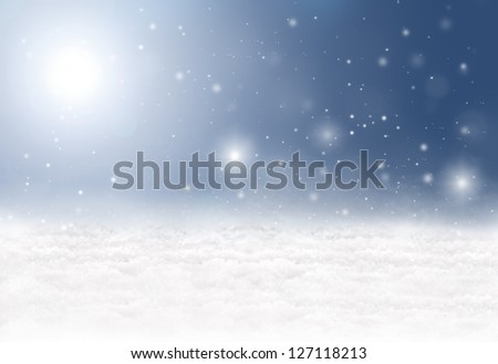 Winter background with snow, snowflakes, sunshine and a blue sky - stock photo