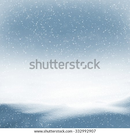 Winter background with snowdrifts and the falling snow - stock photo
