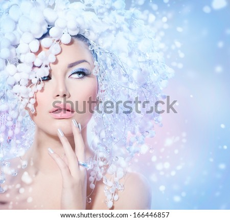 Winter Beauty Woman. Beautiful Fashion Model Girl with Snow Hair style and Make up. Holiday Makeup and Manicure. Winter Queen with Snow and Ice Hairstyle - stock photo