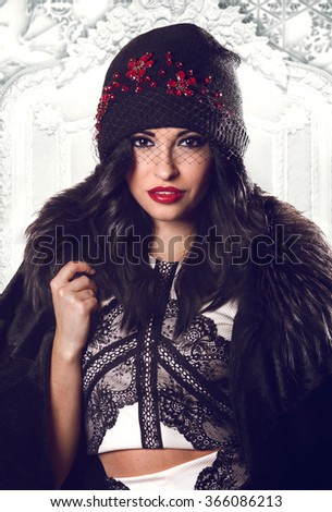 Winter Beauty Woman. Evening Girl Makeup. Holiday Make-up. High Fashion Portrait Model Red Lips, Fur Coat. Crystals and Retro Veil on the Hat - stock photo