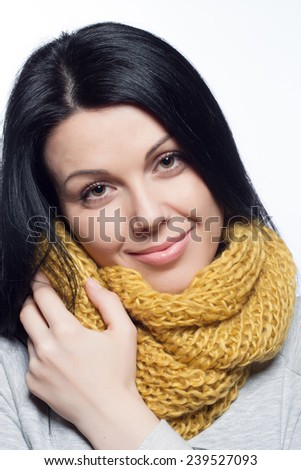 Winter Beauty Woman. Fashion Girl Concept. Skin and hair care in cold season. Portrait of a young girl with scarf, gloves and sweater. - stock photo