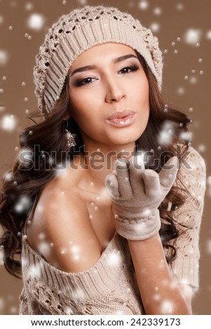 Winter beauty young woman portrait,model creative image with makeup, with porcelain skin and long lashes. showing. studio portrait - stock photo
