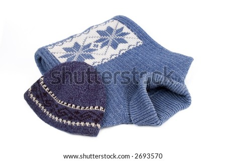Winter blue sweater and cap with  ornament isolated over white - stock photo