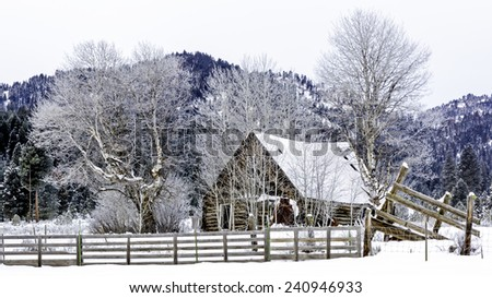Winter Cabin in the forest of Idaho - stock photo