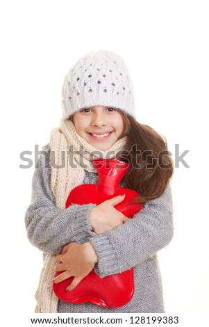 winter child hugging hot water bottle for warmth - stock photo