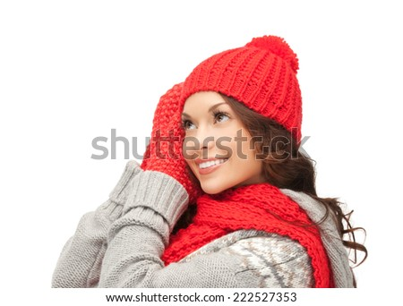 winter, christmas, holidays, clothing and people concept - smiling asian woman in red hat, scarf and mittens over white background - stock photo