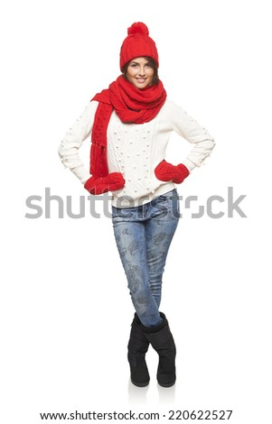 Winter, christmas, holidays concept. Smiling beautiful woman in red hat, scarf and mittens standing in full length over white background - stock photo