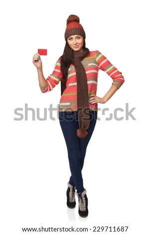 Winter, christmas, holidays concept. Smiling beautiful woman in winter clothing standing in full length with credit card over white background - stock photo