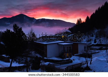 Winter dawn after snow storm at Zell am See in Austrian Alps, Tyrol, Austria - stock photo