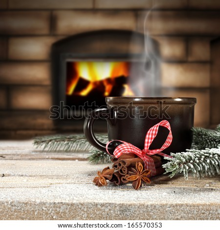 winter drinks and fireplace  - stock photo