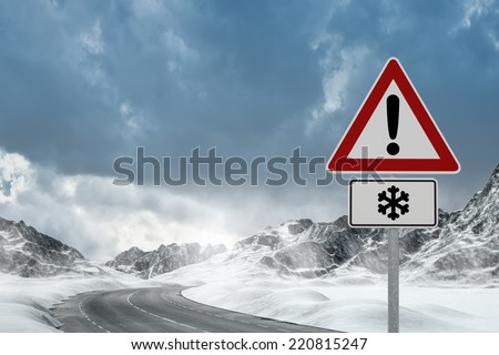 Winter Driving - Winter Road Country road leading through a winter mountain landscape. - stock photo