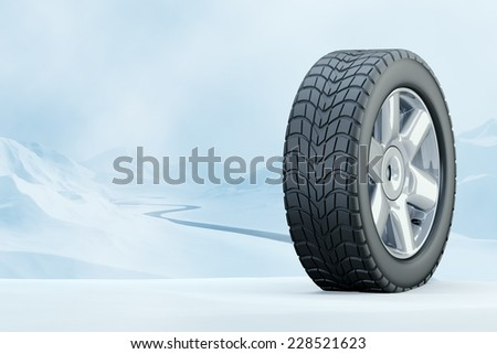 Winter Driving - Winter Tire - Winter tire in front of a snowy mountain landscape. Computer generated image - stock photo
