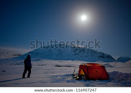 Winter Expedition on the Kungsleden - Tent under The Moon - stock photo