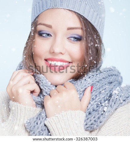 Winter face close up of young attractive happy smiling woman covered with snow flakes. Christmas concept.  - stock photo