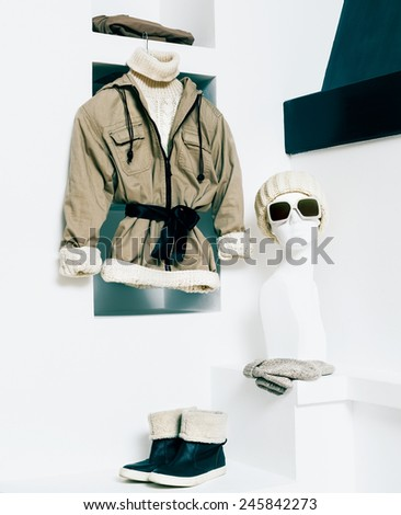 Winter Fashionable Clothing. Beige color in clothing. Urban active style - stock photo