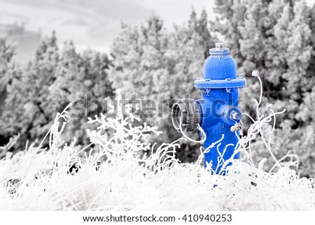 Winter Fire Hydrant with Snow and Frost Around - stock photo