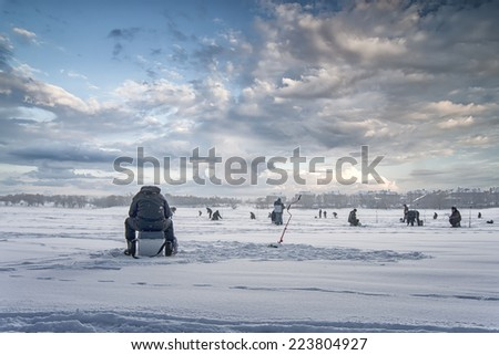 winter fishing on ice, natural background - stock photo