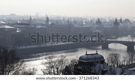 Winter foggy snowy Prague with its Bridges, Czech Republic - stock photo