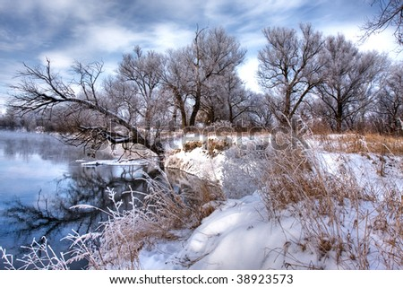 Winter forest river and trees on the shore - stock photo