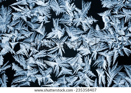 Winter frosted drawing on window glass - stock photo