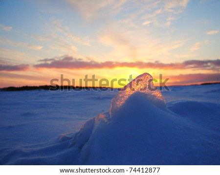 Winter frozen sea sunset and gold ice in Finland - stock photo
