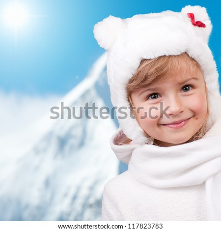 Winter fun, kid , snow - winter portrait of lovely little girl on winter holidays - stock photo