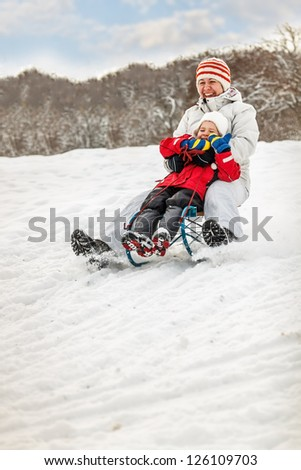 Winter fun, sledding at winter time - stock photo