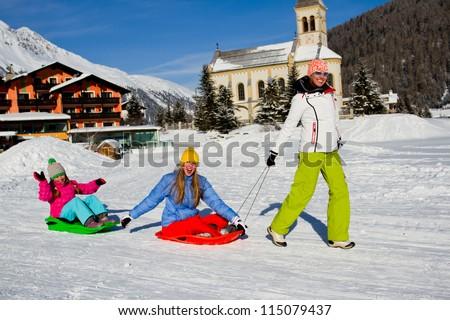 Winter fun, snow, family sledding at winter time - stock photo