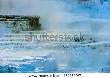 Winter Geyser cascade - Yellowstone National Park  - stock photo