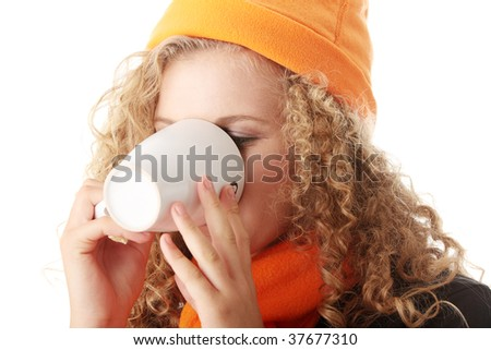 Winter girl with cup of hot tea - stock photo