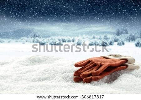 winter gloves on snow  - stock photo