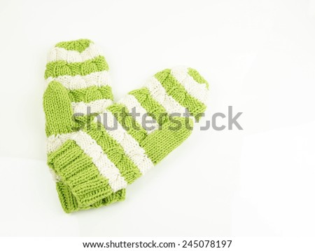 Winter green with white mittens - stock photo