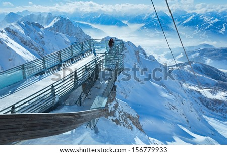 Winter hazy mountain view from upper station cable car to Dachstein (Austria) - stock photo