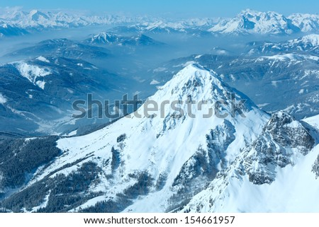 Winter hazy veiw from Dachstein mountain massif top to Schladming and Filzmoos region (Austria). - stock photo