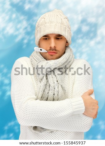 winter, health, medicine concept - sick man with thermometer in his mouth - stock photo