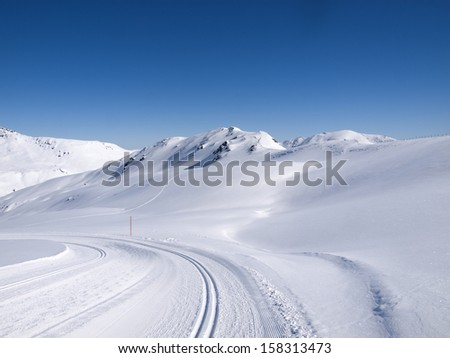 Winter hiking and langlauf trail in the alps at Koenigsleiten Austria - stock photo