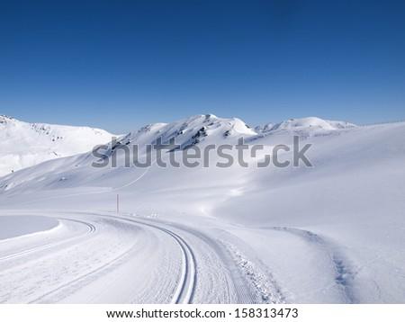 Winter hiking and langlauf trail in the alps at Koenigsleiten Austria - stock photo