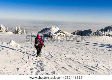 winter hiking to the hut - stock photo